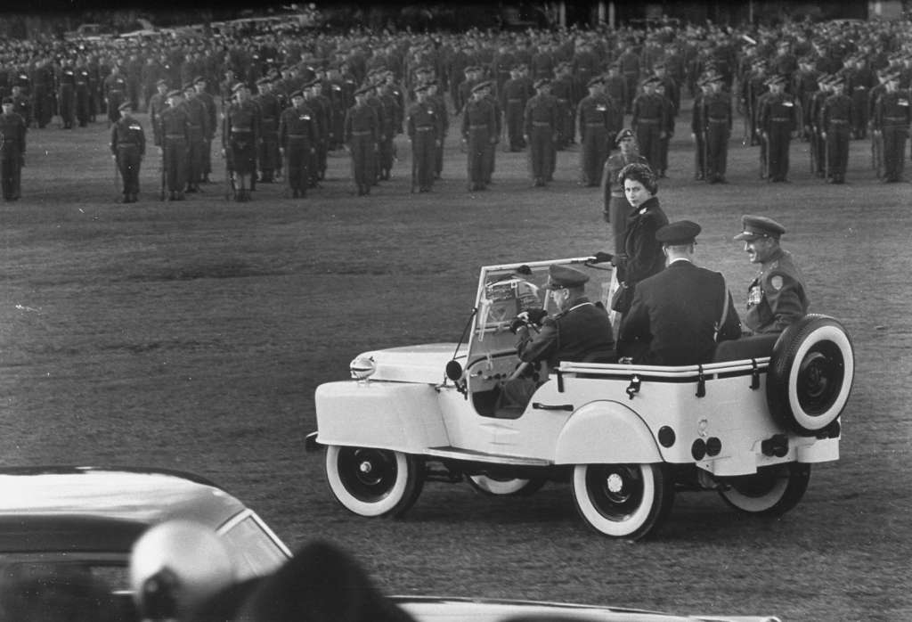 Her royal balance was preserved by Princess Elizabeth when she was trundled about in a white jeep inspecting Canadian troops_1024x1024.jpg