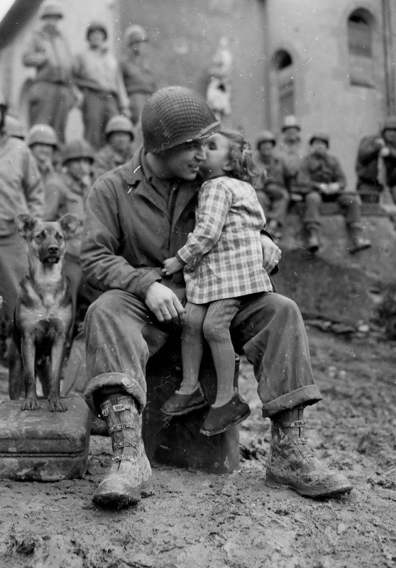 9th Armored Division technician Alvin Harley with a little French girl on Valentine's Day 14 Feb 1945.jpg
