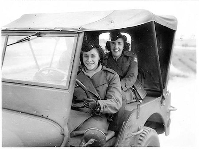 Eileen McLellanseated in the back of a jeep in Japan-1945.jpg