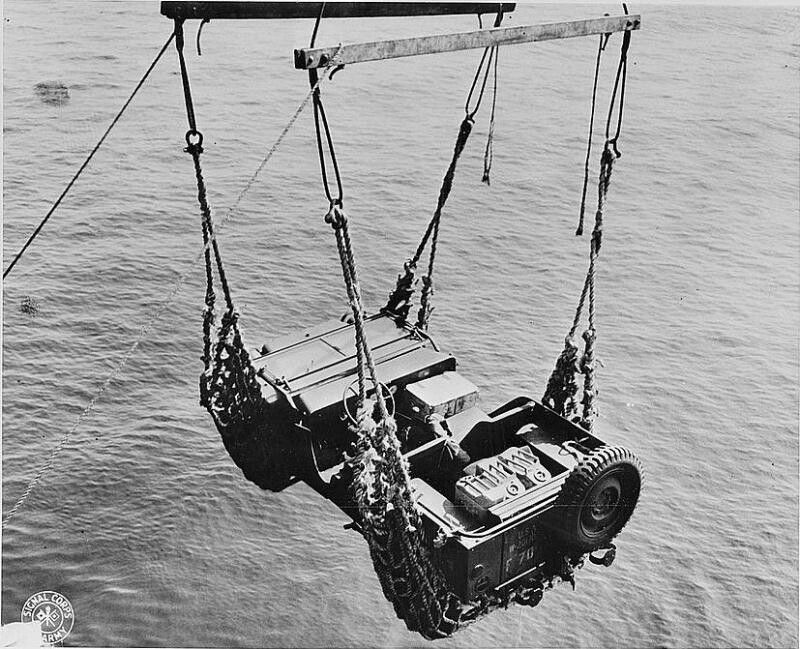 Hoisting a Jeep to a Ship using cargo nets and frame.jpg