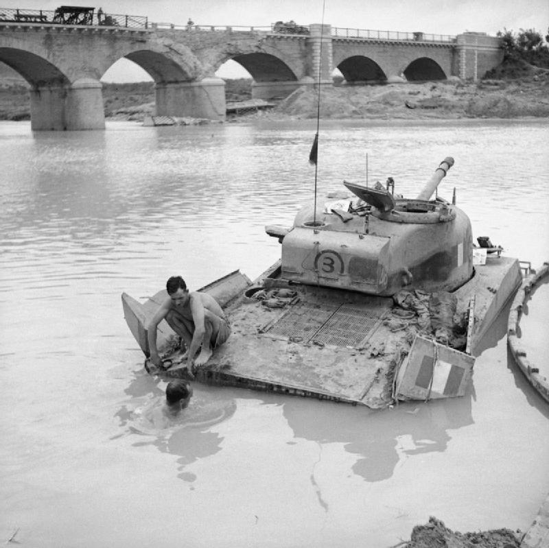 A_Sherman_tank_being_recovered_from_the_river_Biferno_near_Campo-Marino,_Italy,_October_1943._NA7725.jpg