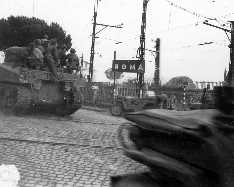 american_m4_sherman_tanks_and_jeeps_enter_rome_italy_june_1944.9w9zx2xv308wg4ckkso8wo8os.ejcuplo1l0oo0sk8c40s8osc4.th.jpeg