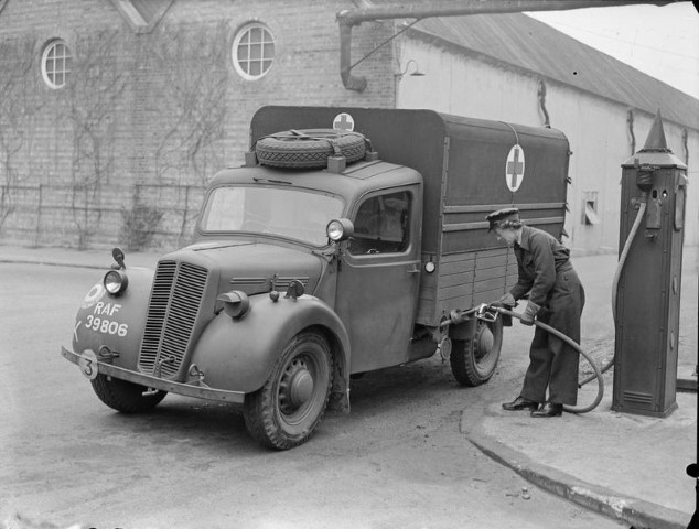 A WAAF driver refuels her Morris Type %27C%27 ambulance at a petrol pump outside the workshops at Cardington%2C Bedfordshire. %28Small%29.jpg