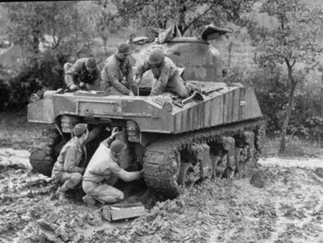 79th Ordnance Co. soldiers repairing a Sherman tank in the mud at their field depot%2C in the Cassino corridor of battle.Italy %2CFebruary 1944 %28Small%29.jpg