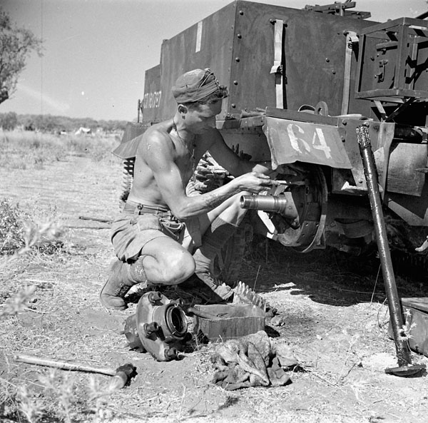 Private R.E. Hill repairing his Universal Carrier%2C Catania%2C Italy%2C 22 August 1943..jpg