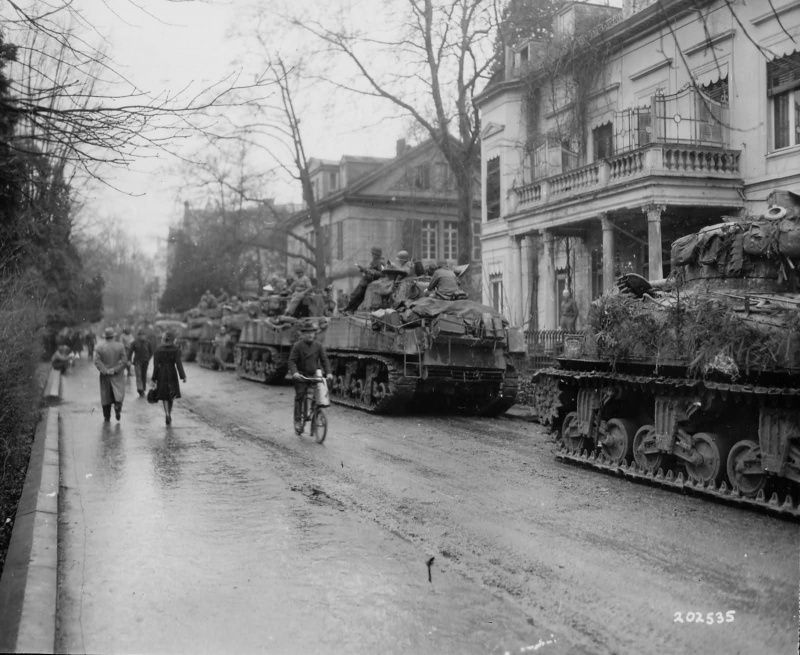 7th_armored_division_m4_sherman_platoon_in_bad_godesberg_germany_march_1945.f5i36vhiieosksgscsg84soso.ejcuplo1l0oo0sk8c40s8osc4.th.jpeg